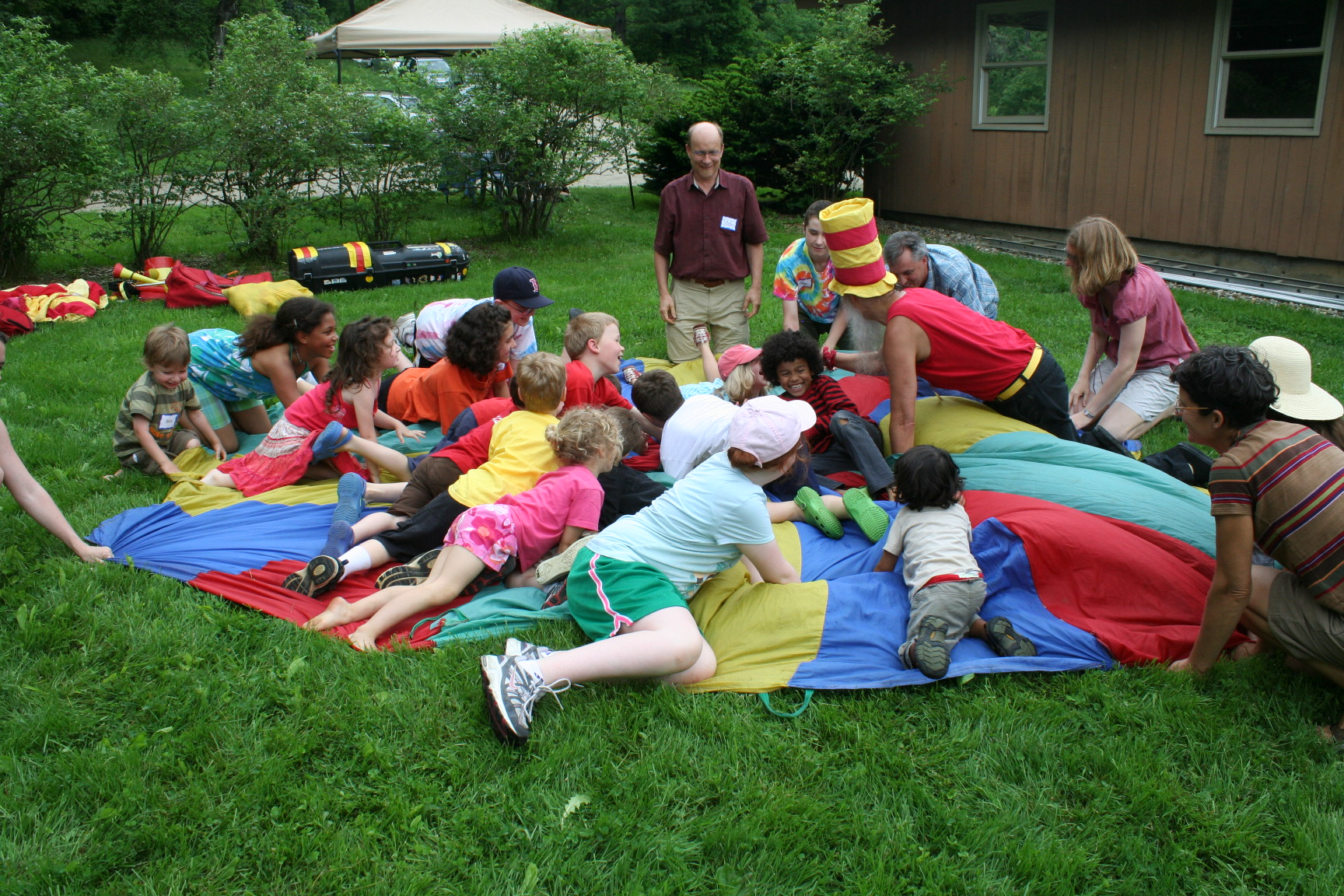Trevor and pig pile on the parachute at Katywil Family Day