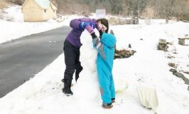 Building snow person at Stowe Farm Community