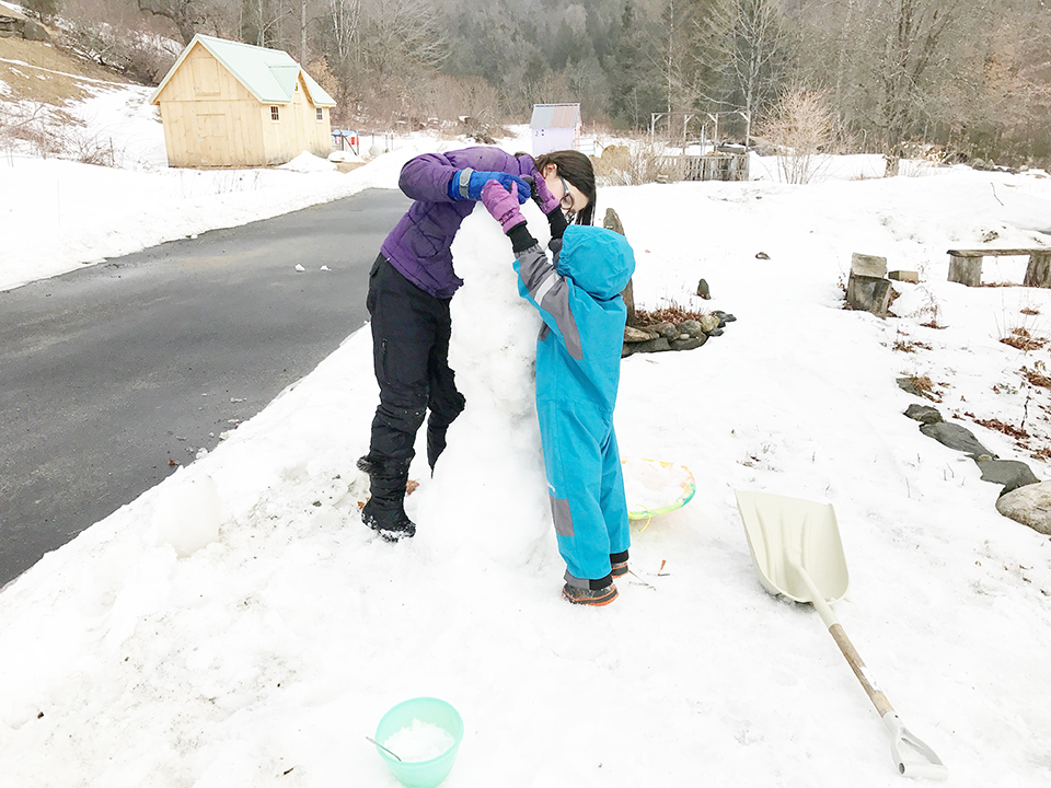 Monique and Lucy, building snow person at Stowe Farm Community