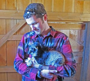 Mason with one of Stowe Farm baby goats