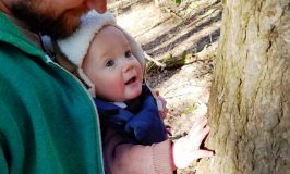 Baby's first experience touching a tree